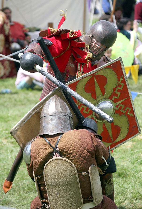 David Baggott of Seattle battles a contestant in the armor combat at the June Faire in Port Gamble on Saturday. LARRY STEAGALL / KITSAP SUN
