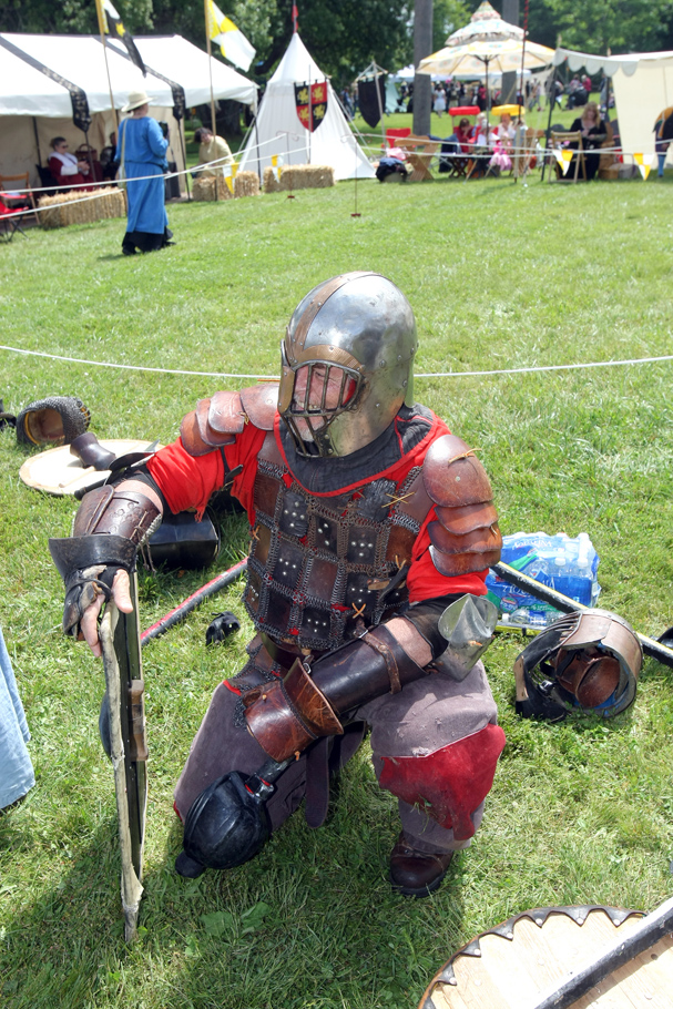 Jack Crockett of Bremerton takes a rest after armor combat at the June Faire in Port Gamble on Saturday. LARRY STEAGALL / KITSAP SUN