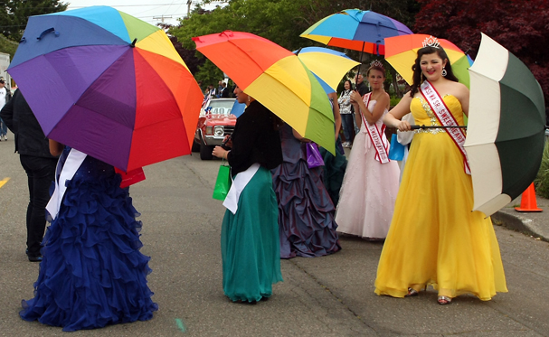 Miss Washington Senior Sweetheart Holly Wasson, right, and fellow members of the parade royalty mingle in the rain prior to the start of the Viking Fest Parade on Saturday, May 18, 2013. (MEEGAN M. REID / KITSAP SUN)