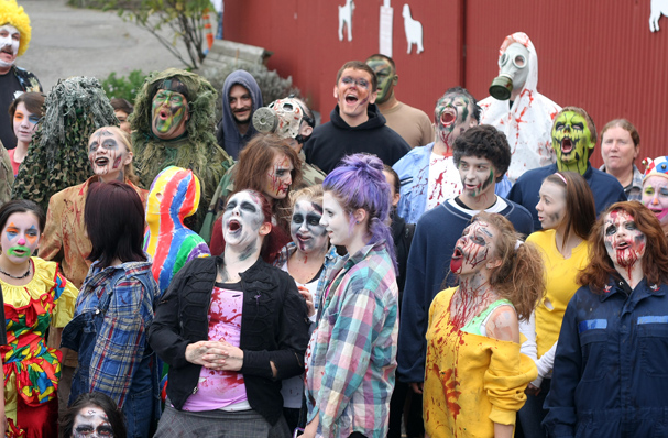 Kitsap Haunted Fairgrounds actors screen to the moon at the start on Friday. (LARRY STEAGALL / KITSAP SUN)