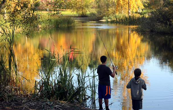 Allan Griffiths,13, and Will Price,12, fish in the pond with the reflection of fall at Battle Point Park on Bainbridge Island on Monday. (LARRY STEAGALL / KITSAP SUN)