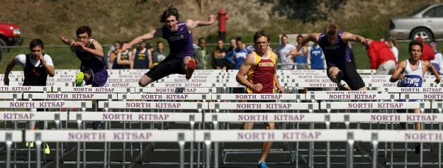 Kingston's Garrett Rouser, center, takes the lead in the boys 300m hurdles at the Lil' Norway track and field invitational in Poulsbo on Saturday, April 12, 2014. (MEEGAN M. REID /KITSAP SUN