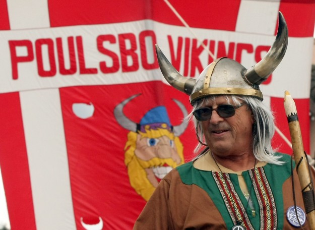 Tom Lucas plays the part of a viking as he takes part in Poulsbo's Viking Festival Parade on Saturday, May 17, 2014. (MEEGAN M. REID /KITSAP SUN)