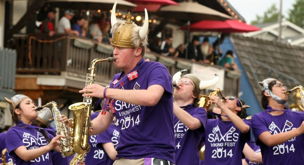 The University of Washington Husky Saxes play their way down the parade route on Saturday, May 17, 2014. (MEEGAN M. REID /KITSAP SUN)