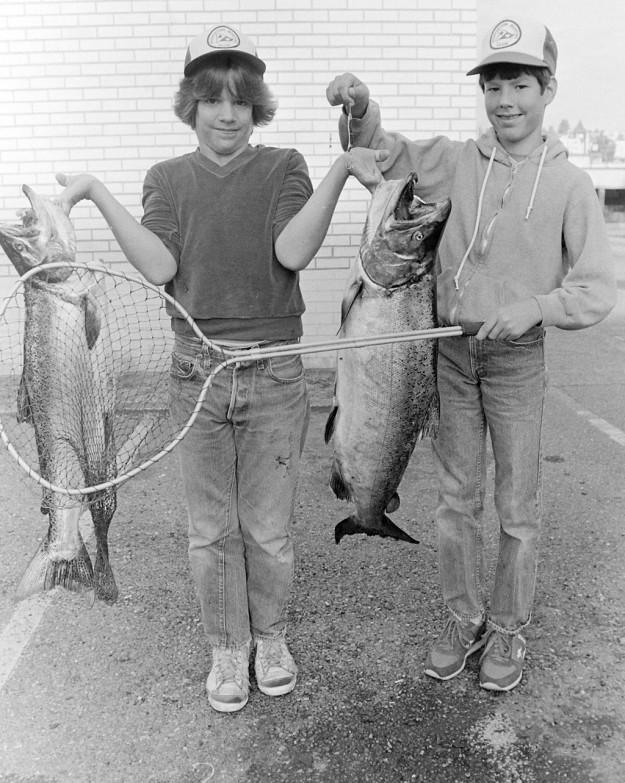 8/18/83 Kids with large salmon. Theresa Aubin Ahrens / Bremerton Sun