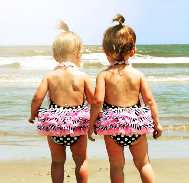 """Twins At The Beach"" by Kayleigh Lewis Oh my this is just an adorable shot of two twins who of course are sporting matching hairdos and swimsuits while enjoying a summer day at the beach."
