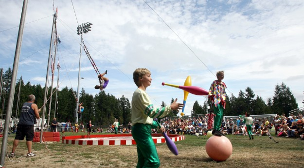 Fairgoers watch the Wenatchee Youth Circus at the Kitsap County Fair & Stampede. (LARRY STEAGALL / KITSAP SUN)