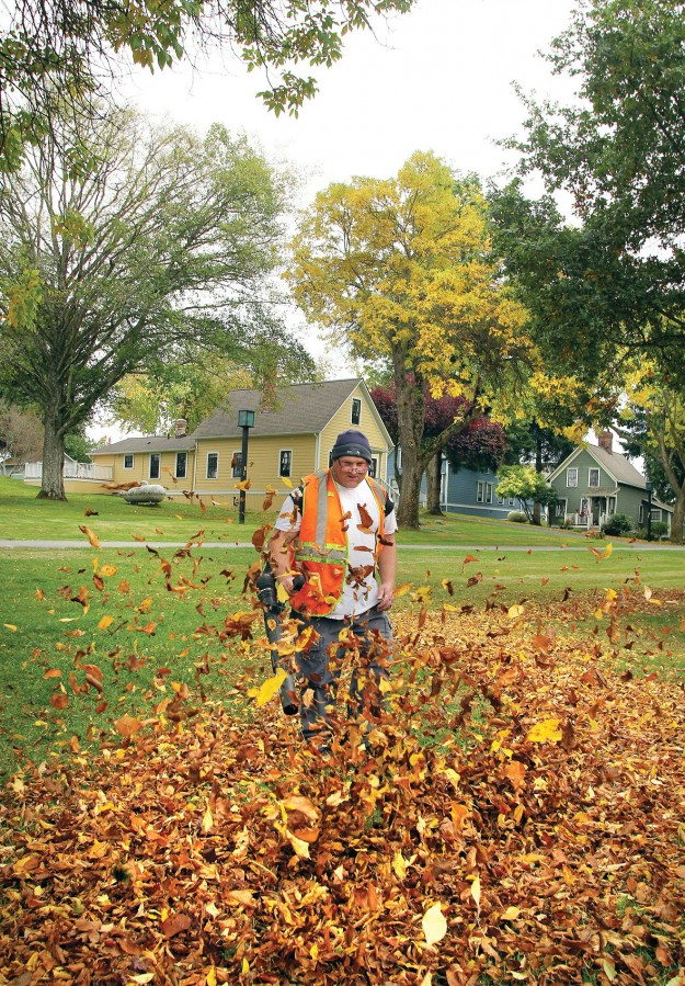 Pope Resources lead landscaper Lonnie Hyde cleans up the fallen leaves in Port Gamble. LARRY STEAGALL / KITSAP SUN