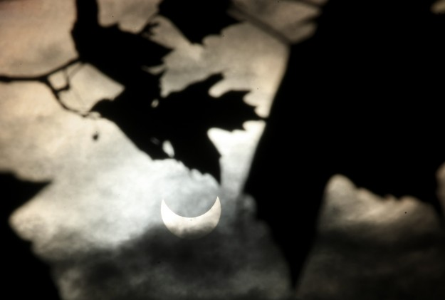 A partial eclipse of the sun is just visible through the clouds above Poulsbo's Waterfront Park on Thursday, October 23, 2014. (MEEGAN M. REID / KITSAP SUN)