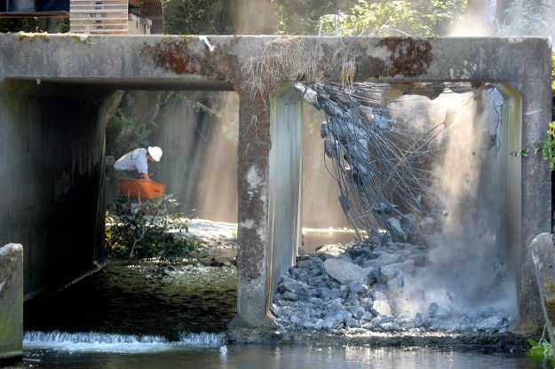 Half of the Chico Creek culvert is ripped up on Tuesday. The old culvert is being removed. LARRY STEAGALL / KITSAP SUN