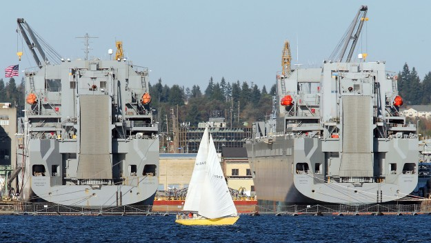 A sailboat cruises past the PSNS Shipyard as seen from the Port Orchard Waterfront on a brisk Tuesday, November 11, 2014. (MEEGAN M. REID / KITSAP SUN)