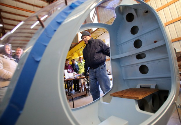 Bill Swope is framed by the cockpit of a helicopter that he is building during a field trip of Central Kitsap Junior High aviation students to Apex Airpark in Silverdale on Wednesday, November 12, 2014. (MEEGAN M. REID / KITSAP SUN)