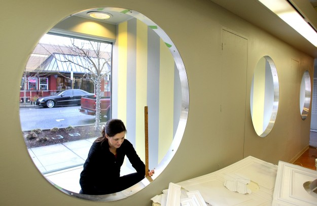 Ashleigh Lauber measures as she works in a display window of the new Purpose Boutique at Fourth and Pacific in downtown Bremerton. The new shop plans to open on Jan. 10. LARRY STEAGALL / KITSAP SUN