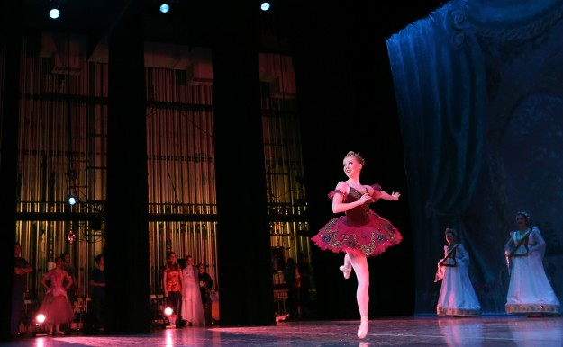 Sophie Robertson dances across the stage in the role of the Sugar Plum Fairy during Peninsula Dance Theatre's rehearsal for the Nutcracker at the Bremerton High School Performing Arts Center on Tuesday, December 2, 2014. (MEEGAN M. REID / KITSAP SUN)