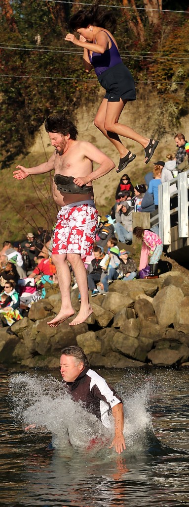 A trio of plungers take part in the annual Olalla Polar Bear Plunge on Monday, January 1, 2015. (MEEGAN M. REID / KITSAP SUN)