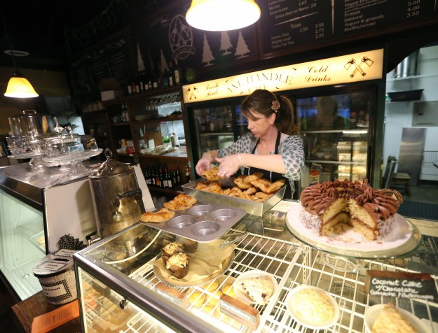 Server/Barista Jenn Kirkpatrick places freshly baked quiches into a serving dish at the Axe Handle Cafe in Kingston on Friday, January 2, 2015. (MEEGAN M. REID / KITSAP SUN)