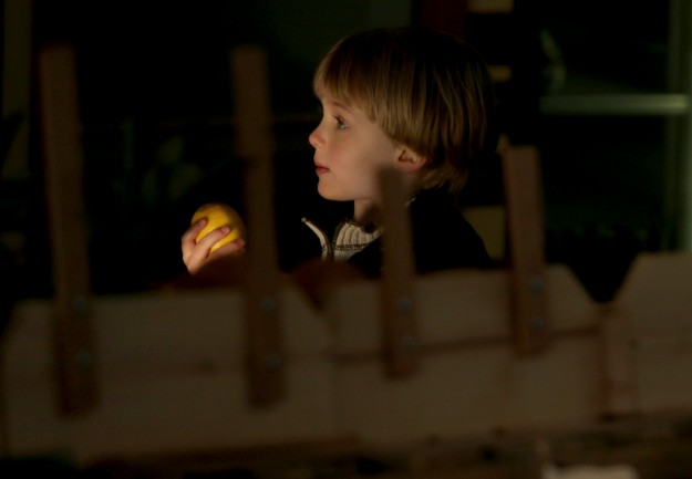 As sunlight streams through the open doors, a youngster carries a lemon through the Port Orchard Public Market in Port Orchard on Wednesday, January 14, 2015. (MEEGAN M. REID / KITSAP SUN)