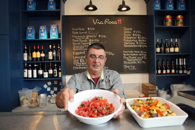 Owner Pino Sordello at the Via Rosa 11 Italian Kitchen & Market on Bainbridge Island., puts out vegetarian lasagna. LARRY STEAGALL / KITSAP SUN