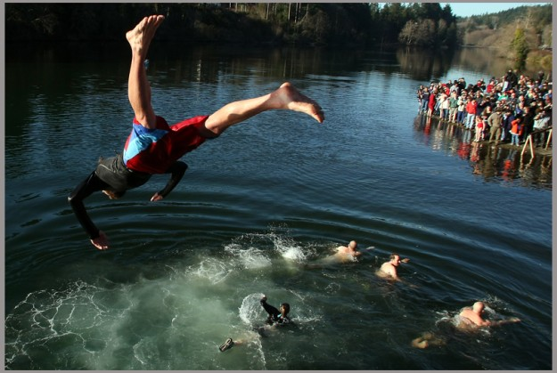 Thrill seekers jump off the bridge as they take part in the annual Polar Plunge in Olalla on Saturday. (MEEGAN M. REID | KITSAP SUN)