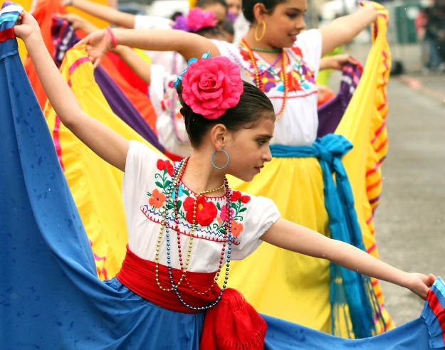 Nobleza Folklorica dancer Mariana Corona, 8, performs at the Cinco de Mayo celebration in Bremerton on Saturday, May 3, 2014. (MEEGAN M. REID /KITSAP SUN)