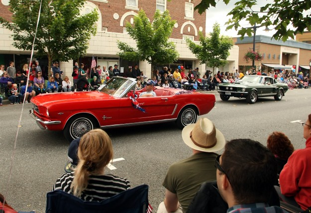 The Kitsap Mustang Club travels down Pacific for Bremerton's Armed Forces Day Parade on Saturday, May 17, 2014. (MEEGAN M. REID /KITSAP SUN)