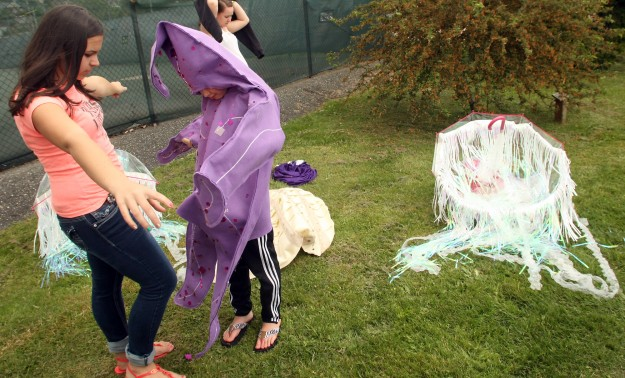 Ashley DeSalvo, 15, helps Hailey Knott, 10, with her starfish costume prior to the start of Poulsbo's Viking Festival Parade on Saturday, May 16, 2014. (MEEGAN M. REID /KITSAP SUN)