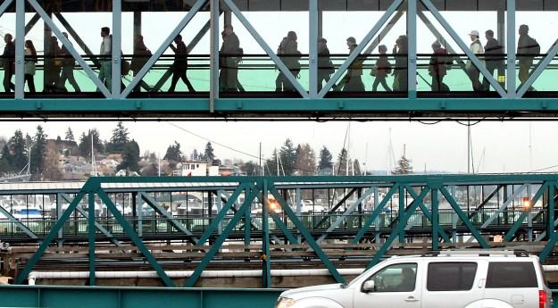 Pedestrian traffic uses the walkway as vehicles disembark below at the Bremerton Ferry Terminal after the docking of the 3:00pm sailing of the MV Kaleetan from Seattle on Tuesday, January 28, 2014. (MEEGAN M. REID / KITSAP SUN)