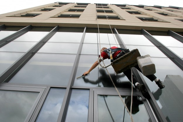 Window washer Jim Mahoney of Pacific Window Cleaning in Seattle works on the Norm Dicks Government Building on Monday. LARRY STEAGALL / KITSAP SUN