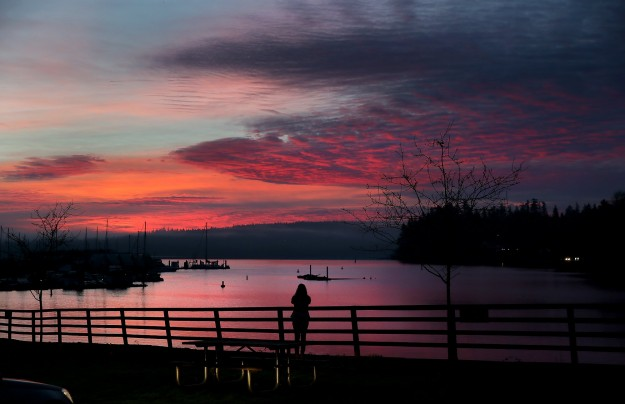 The sunrise at the Brownsville Marina on Friday, lights the sky with hues of red. LARRY STEAGALL / KITSAP SUN