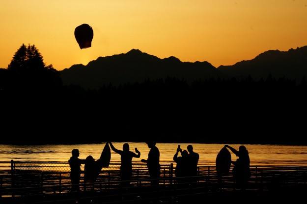 A wish lanterns is put up into the sunset sky from Lions Park in Bremerton on Sunday. A family was doing it in honor or their late father. LARRY STEAGALL / KITSAP SUN