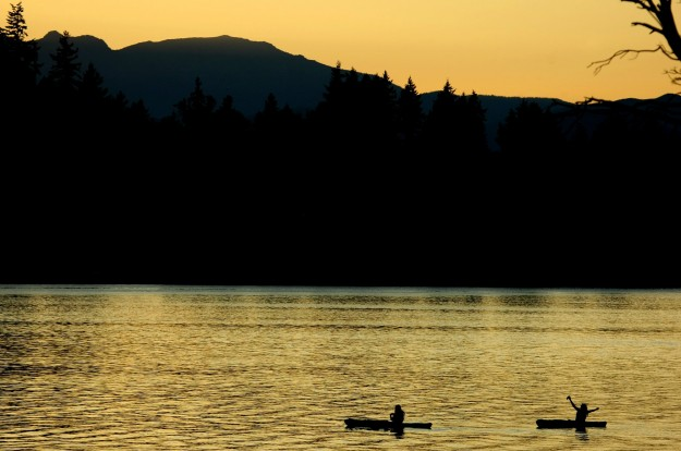A kayaker takes a selfie during sunset along Tracyton Beach Road. LARRY STEAGALL / KITSAP SUN