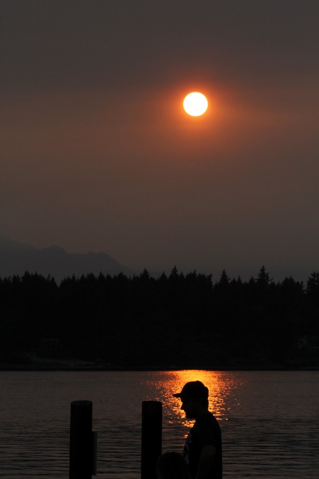 Haze from the fires in the Olympic National Park, and Canada make it a smokey sunset on Tuesday. LARRY STEAGALL / KITSAP SUN