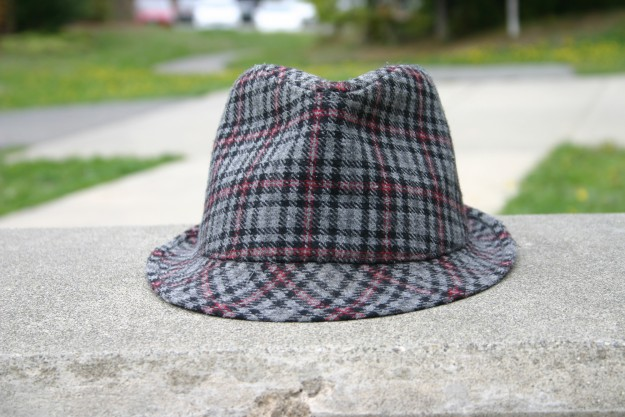 Fedora by Gregory Zink Who's hat is this? Do you think they a young hipster or a very dapper older gentleman? Why did they leave it on a concrete bench? Did a bird a steal it from their head and just drop it there? This is a frame full of questions and I think that is just great . Besides the intrigue of the frame, I like the composition with the hat placed in the center and how Gregory captured the soft texture of the hat.