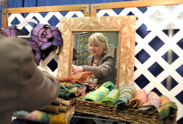 Vendor Arleen Eagan of Tahuya sets up her fiber art display at PresidentÕs Hall at the Kitsap County Fairgrounds on Thursday. She is at the Kitsap QuilterÕs 29th annual Quilt Show. More than 200 quilts are on display. LARRY STEAGALL / KITSAP SUN