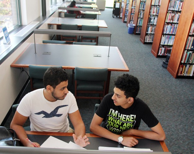 Olympic College in Bremerton students Mohamed Morshed, (left) and Loai Alfarran, study in the Haselwood Library on campus. The are from war torn Yemen. LARRY STEAGALL / KITSAP SUN