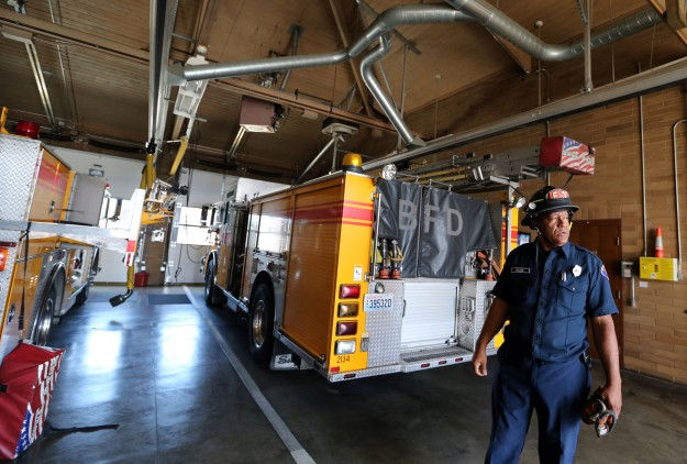 Bremerton firefighter Dave Wallace moves through the apparatus bay of Bremerton Fire Station no. 3 as he and crew members work through a drill on Monday, July 13, 2015. The Bremerton Fire Department will be seeking a voter-approved levy for funds to update vehicles, equipment and stations in November. (MEEGAN M. REID / KITSAP SUN)