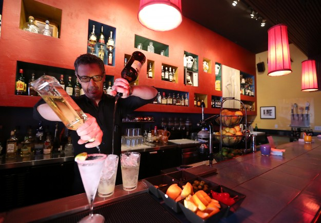 Bartender Milo Goodrich mixes up a pair of margaritas at Paella Bar in Poulsbo on Monday, November 16, 2015. (MEEGAN M. REID / KITSAP SUN)