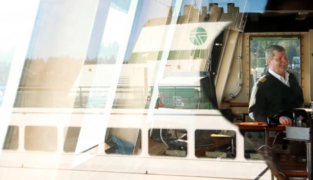 The M/V Walla Walla is reflected in the window of the M/V Evergreen State's wheelhouse window as Captain Jamie Pelland, of Bainbridge Island, talks about his time aboard the ship which is docked at the Eagle Harbor Maintenance Facility on Bainbridge Island on Thursday, January 14, 2015. . (MEEGAN M. REID / KITSAP SUN)