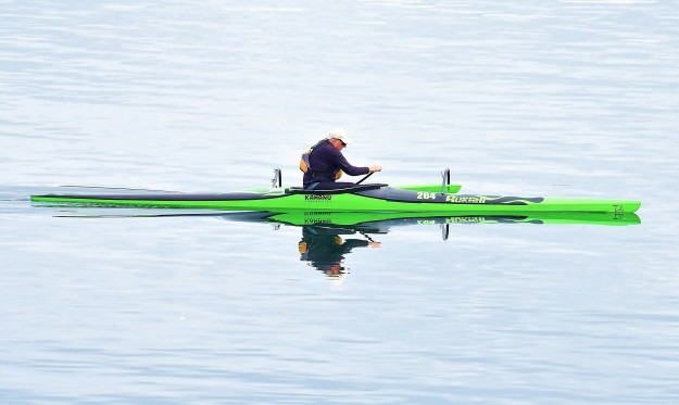 Can do, in a Green Kamanu by Jack C. Harpel I really like the symmetry of the subject and the center composition of this green kayak paddler. The exposure of the image is also fabulous with perfectly saturated colors and tack-sharp focus.