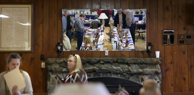 The display tables are reflected in a mirror at the Kitsap County Woodcarvers show at the West Side Improvement Club in West Bremerton. The show continues on Sunday. LARRY STEAGALL / KITSAP SUN