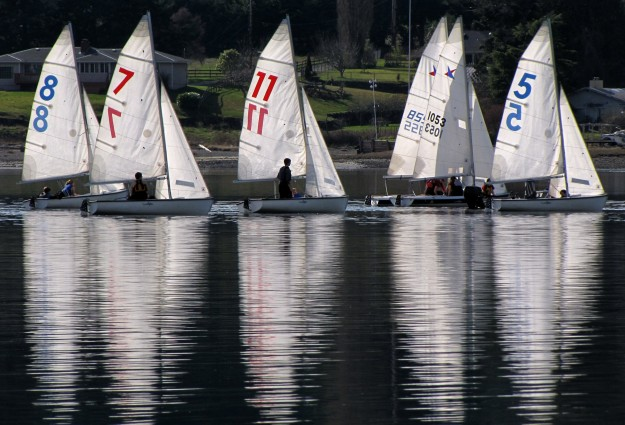 Sails are reflected in the water at Liberty Bay in Poulsbo as the sun lights up the sails on the small boats. LARRY STEAGALL / KITSAP SUN