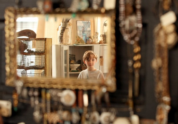 Cormac Burke, 9, is reflected in a mirror as he and his mother Bridget shop at the Uptown Mercantile & Marketplace in Bremerton on Thursday, April 3, 2014. (MEEGAN M. REID / KITSAP SUN)