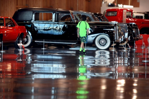 Cars reflect on the sunny floors in the showcase gallery at the LeMay America's Car Museum in Tacoma. LARRY STEAGALL / KITSAP SUN