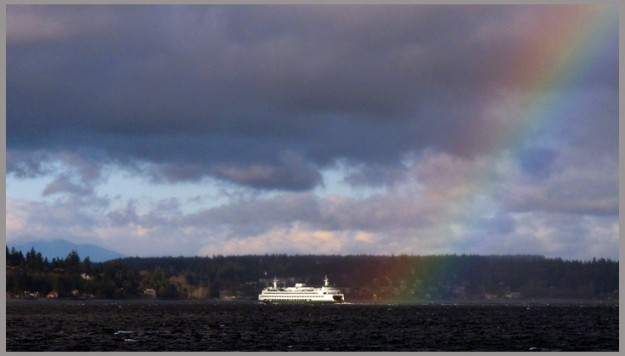 The 11:25 am Seattle to Bainbridge ferry passes near the end of a rainbow as it heads to Eagle Harbor on Sunday, December 11, 2011. MEEGAN M. REID/KITSAP SUN