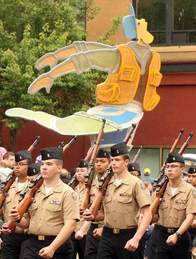 Members of the South Kitsap High School Wolf Battalion Naval Junior ROTC march along Pacific Avenue for the Armed Forces Day Parade in downtown Bremerton, Wash. on Saturday, May 16, 2015. (MEEGAN M. REID / KITSAP SUN)
