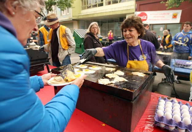 Mayor Patty Lent serves up eggs during the Bremerton Central Lions Club Pancake Breakfast prior to the Armed Forces Day Parade in downtown Bremerton, Wash. on Saturday, May 16, 2015. (MEEGAN M. REID / KITSAP SUN)