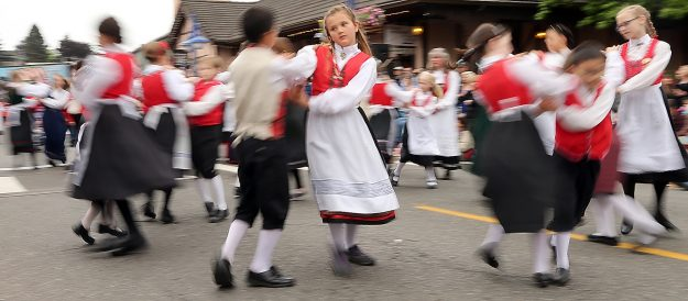 The Poulsbo Sons of Norway Liekarringen Dancers are a blur as they twirl down the street for the annual Viking Fest Parade in Poulsbo, Wash. on Saturday, May 16, 2015. (MEEGAN M. REID / KITSAP SUN)