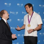 Olympic gold medalist Nathan Adrian of Bremerton speaks with Jim Motz of Safeco Insurance Thursday at the company's 2014 Sochi Olympic Winter Games one-year-out celebration in Seattle.