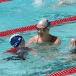 Emily Silver works with young swimmers during a clinic hosted by the Fitter & Faster Tour in Ripon, Calif.