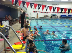 Swimmers take a break during practice for the Poulsbo Piranhas Swim Team at the NK Community pool on Tuesday.